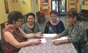 (left to right) Margarita Contreras, Reina Guevara and Lourdes Hernández brief new Executive Director Nelly Jiménez-Arévalo.