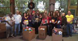 20 volunteers joined ACLAMO staff to spent hours sorting and arranging over 1,500 toys around the sides of the social hall of the Calvary Baptist Church of Norristown.