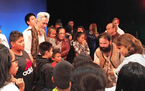 Don Quijote and his sidekick Sancho Panza talk with ACLAMO students after the performance.