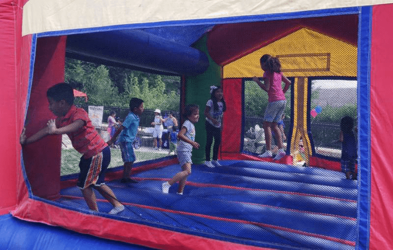 """Children enjoy bouncing on the """"moon"""" while their parents deal with down-to-earth health issues."""